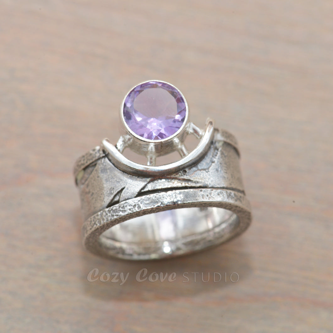 Amethyst ring in a sculptural hand crafted setting of sterling silver. (R703)