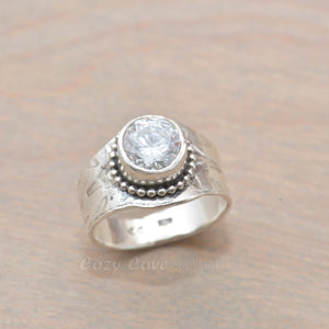 Sparkly cubic zirconia ring in a hand crafted setting of sterling silver. (R705)