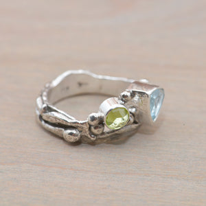 Organic topaz and peridot ring in a hand crafted setting of sterling silver. (R706)