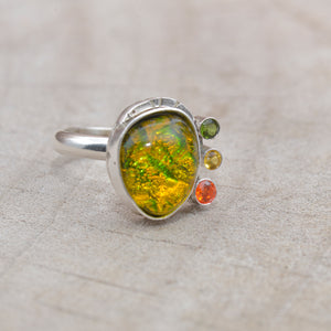 Flashy yellow and green dichroic glass ring in a hand crafted setting of sterling silver. (R708)