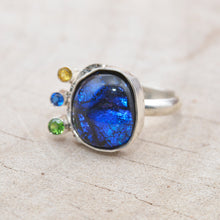 Load image into Gallery viewer, Flashy blue dichroic glass ring in a hand crafted setting of sterling silver. (R709)