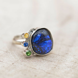 Flashy blue dichroic glass ring in a hand crafted setting of sterling silver. (R709)