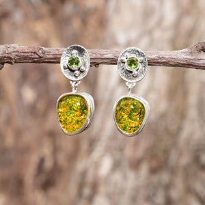 Fiery dichroic glass earrings in  hand crafted sterling silver settings accented with a peridot. (E710)