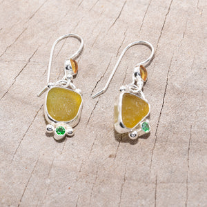 Honey sea glass dangle earrings accented with a sparkly green cubic zirconia and citrine cabochon in settings of sterling silver. (E717)