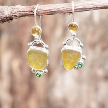 Load image into Gallery viewer, Honey sea glass dangle earrings accented with a sparkly green cubic zirconia and citrine cabochon in settings of sterling silver. (E717)