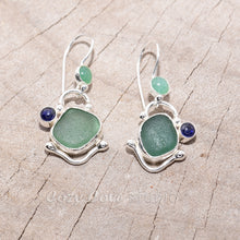 Load image into Gallery viewer, Teal sea glass dangle earrings accented with a sapphire cabochon and citrine cabochon in settings of sterling silver. (E718)