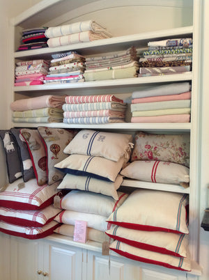 Shelves of lovely fabric & cushions