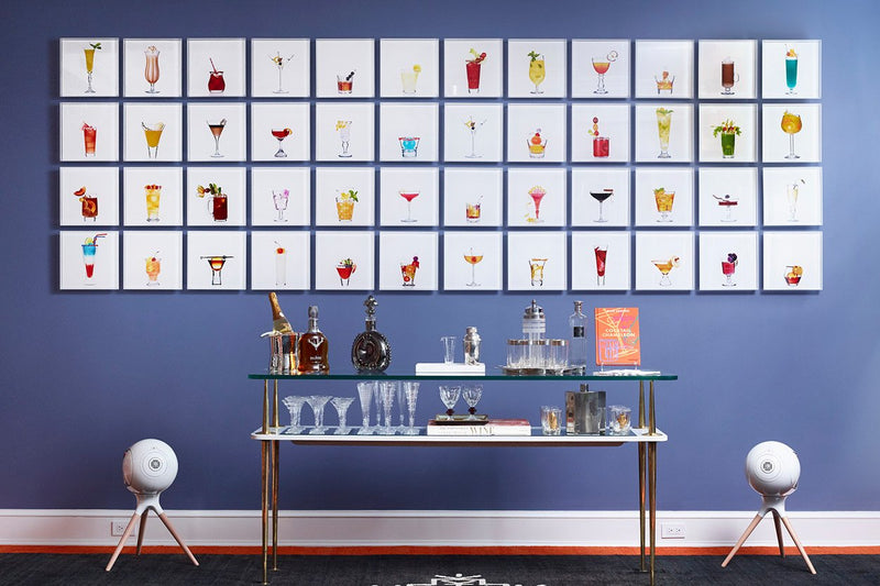 Limited Edition Cocktail Portraits on display over a bar