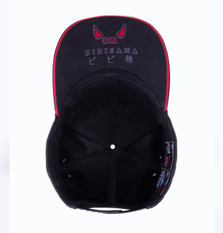 Black snapback hat with original Oni Design- inspired by Japanese Folklore with Bibisama logo at the bottom of the cap