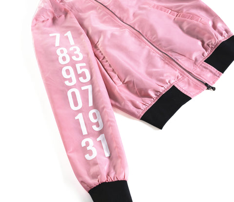Pink Nylon bomber jacket, influenced by the Chinese Zodiac Pig with zipper on the left sleeve and the monkey birth year on the right sleeve.  Has the pig characteristic on the left chest with black and white design inside the jacket. Back of the Jacket is an embroidery of the pig with inside pocket on the left side.