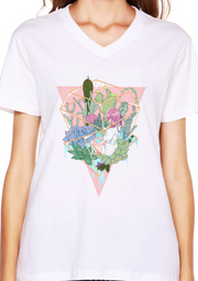 White shirt with Garden dome that has dessert plants growing inside.