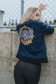 Dark blue bomber jacket influenced by the Chinese Zodiac Rat with a zipper on the left sleeve and the rat birth year on the right sleeve. Has the rat characteristic on the left chest with red and black pattern inside the jacket. Back of the Jacket is an embroidery of the Rat. Inside pocket on the left side.