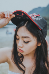Black  snapback hat with original Oni Design- inspired by Japanese Folklore with Bibisama logo under the cap