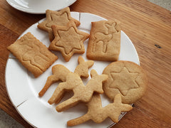 Spiced gingerbread butter cookies.  Cookie cutter shop.