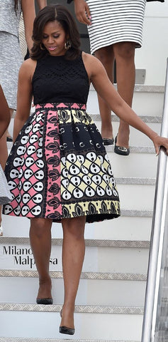 Michelle Obama rocking mid-length african print maxi skirt. Celebrities wearing Ankara fashion.