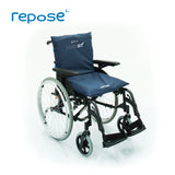 Repose care-sit cushion, with blue cover, placed on a wheelchair to show back and seat in use.