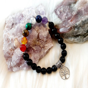 Chakra Bracelet 7 chakra beads complimented by black stones and a tree of life