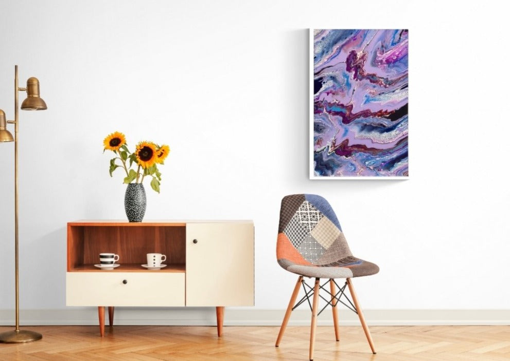 purple and pink painting showcased on a bright wall
