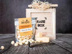 Mature cheddar cheese popcorn in a gift box