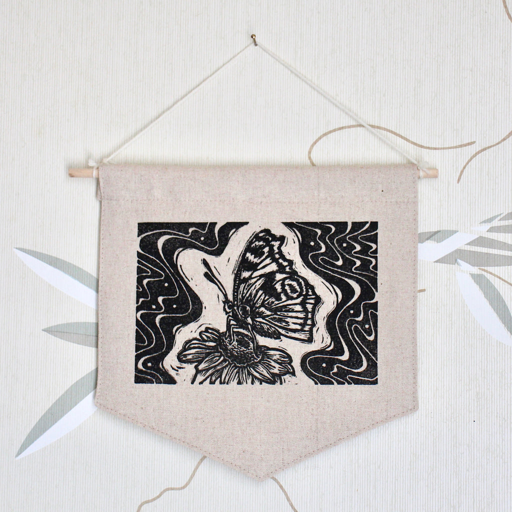 wall hanging with a hand printed butterfly design from a block print. psychedelic butterfly
