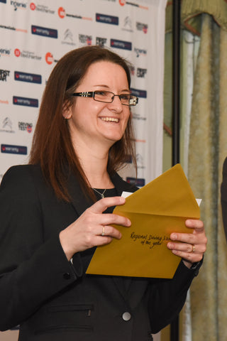 Emma Bagnall, Driving Test Success Brand Manager drawing the winner for Regional Driving School of The Year.