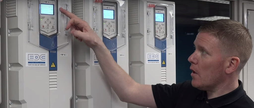 EDC vsd engineer programming an ACQ580 variable speed drive