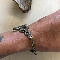 Slithering snake stacking bracelet cuff by Hello Stranger // handmade in the USA // unique statement piece // vintage style oxidized brass /