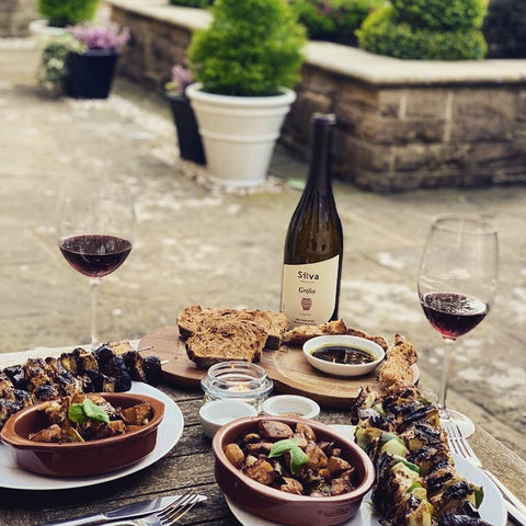 chargrilled chicken served outside with red silva daskalaki greek wine from liatiko grape