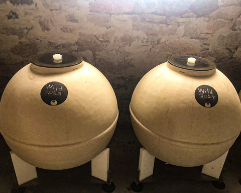 concrete egg-shaped vessel called amphora for holding and fermenting wine in santorini