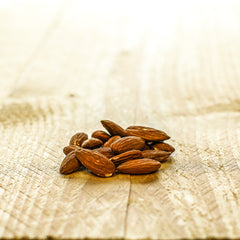 a small handful of almonds on a wooden board