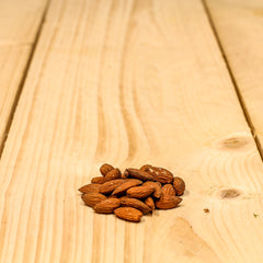 close up photo of a handful of almonds