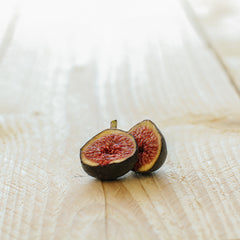 a sliced fig on a wooden board