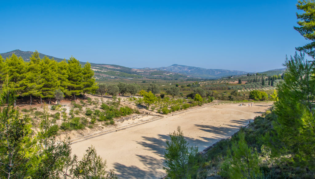 Ancient games arena in nemea surrounded by lush greenery