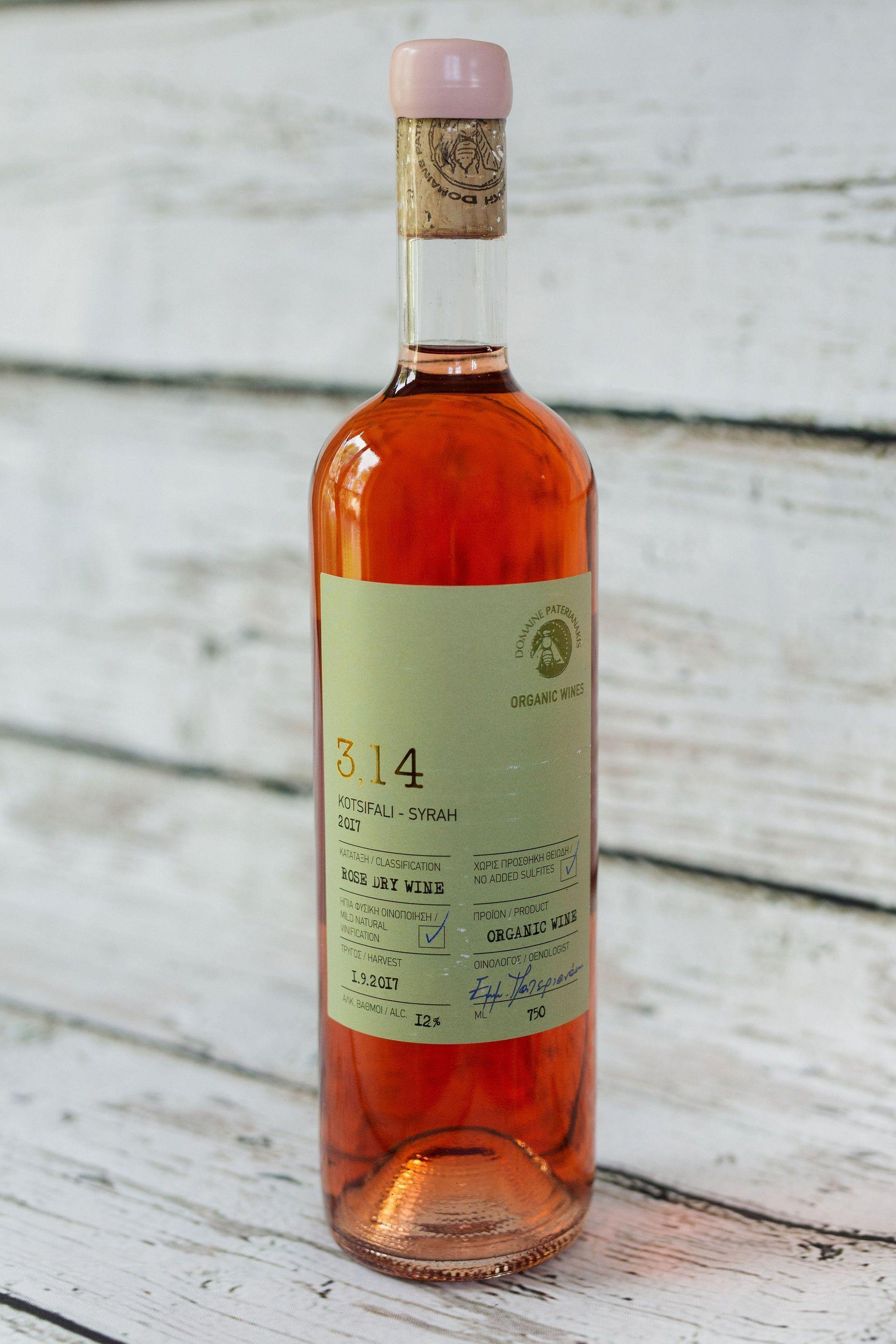 750ml clear wine bottle of 3.14 Kotsifali rosé wine from Domain Paterianakis with green label, cork with pink wax seal