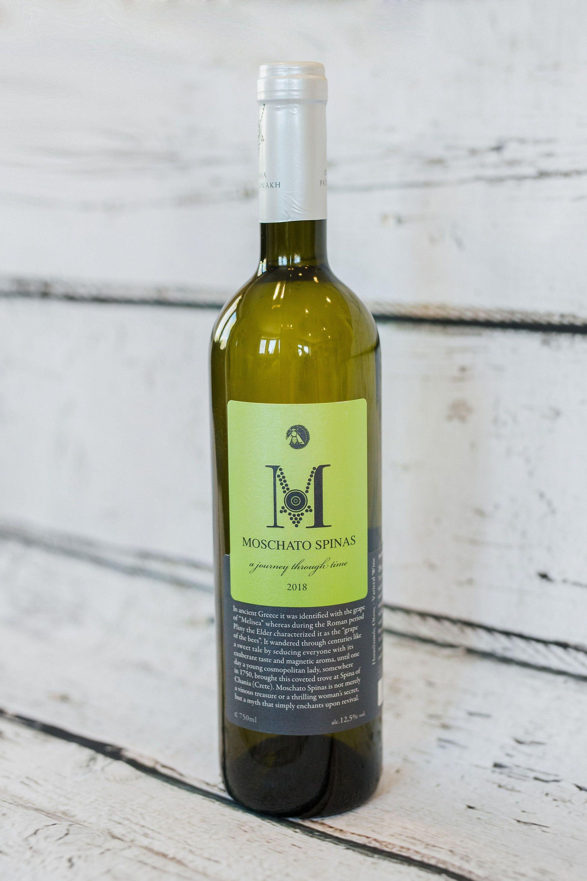 750ml green wine bottle of Moschato Spinas white greek wine from Domain Paterianakis with front yellow label, cork with foil cap