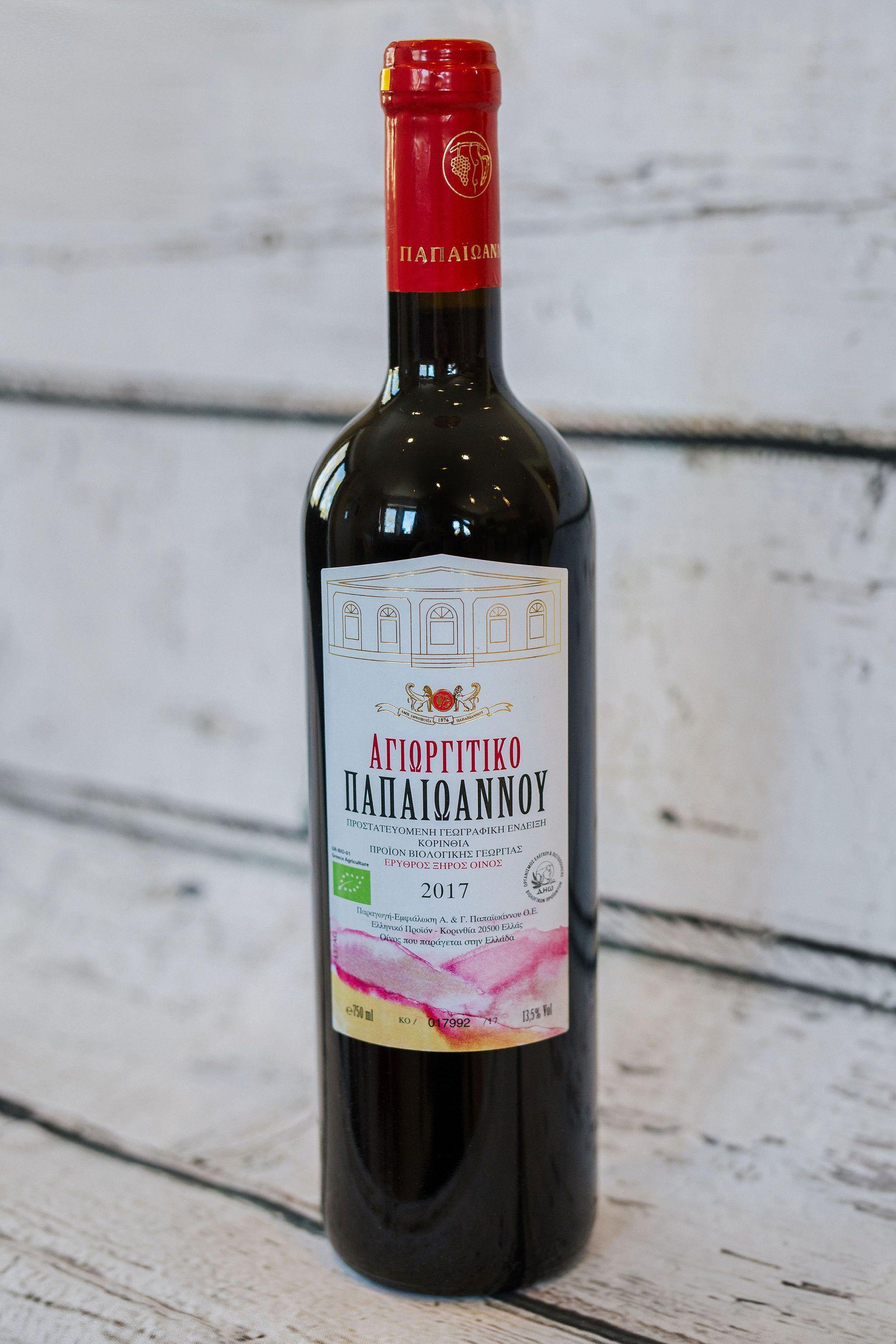 750ml brown wine bottle of red wine from Papaioannou with front label and cork with red foil label