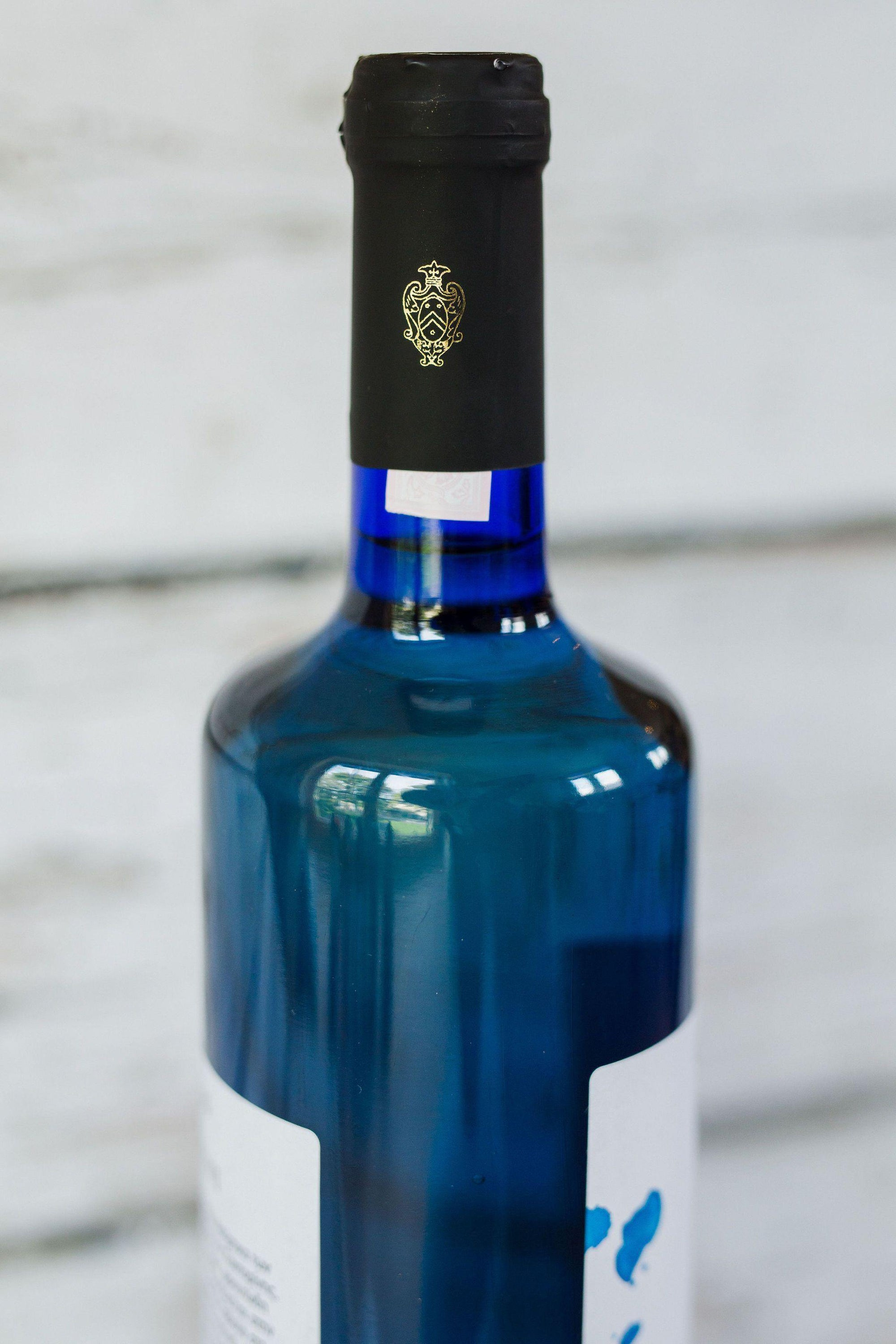 750ml blue wine bottle of Santorini white wine from Gavalas with front label and cork with black foil label
