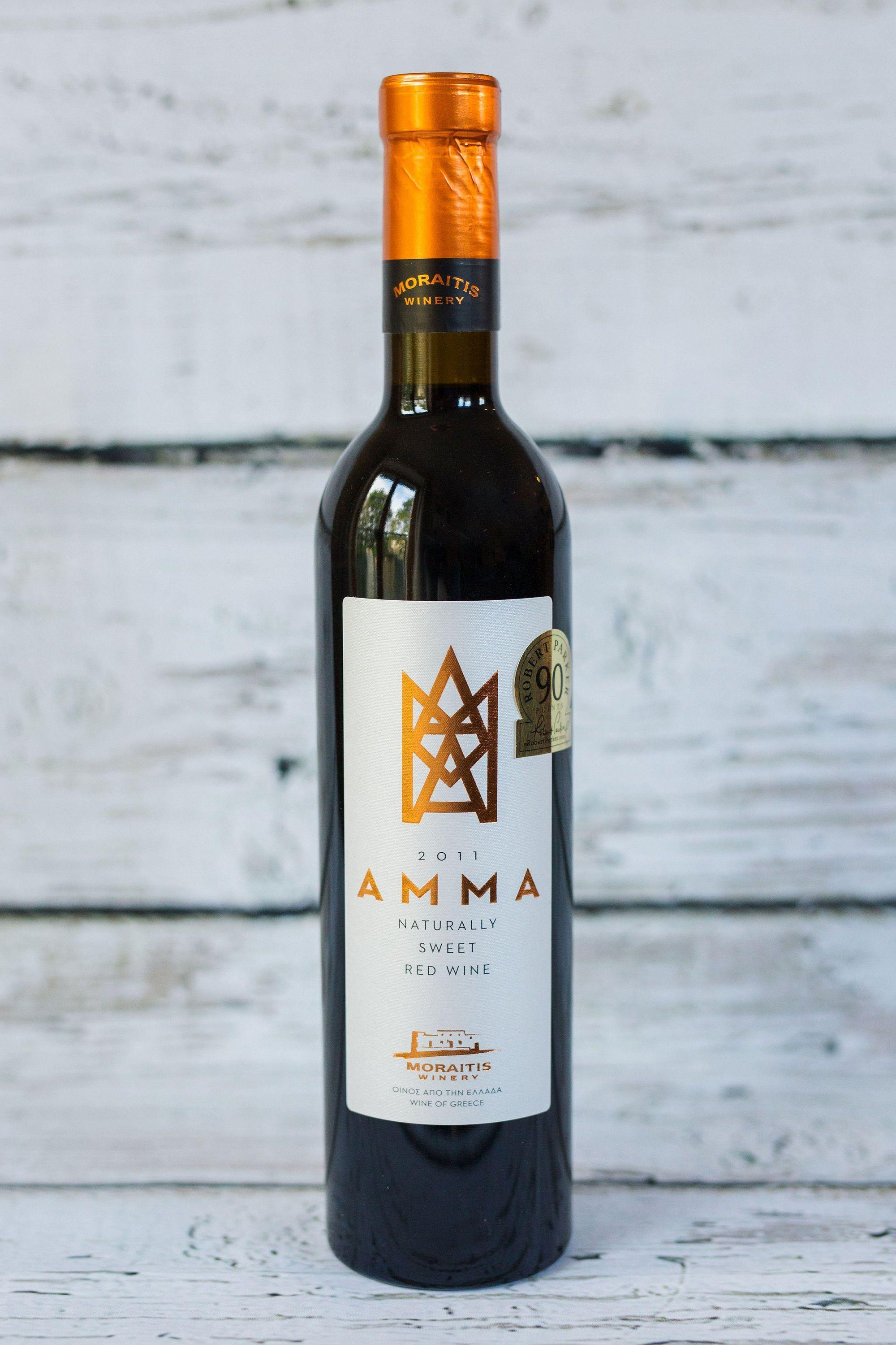 500ml brown glass bottle of Moraitis Amma Red Sweet Wine with front label and gold foil cap