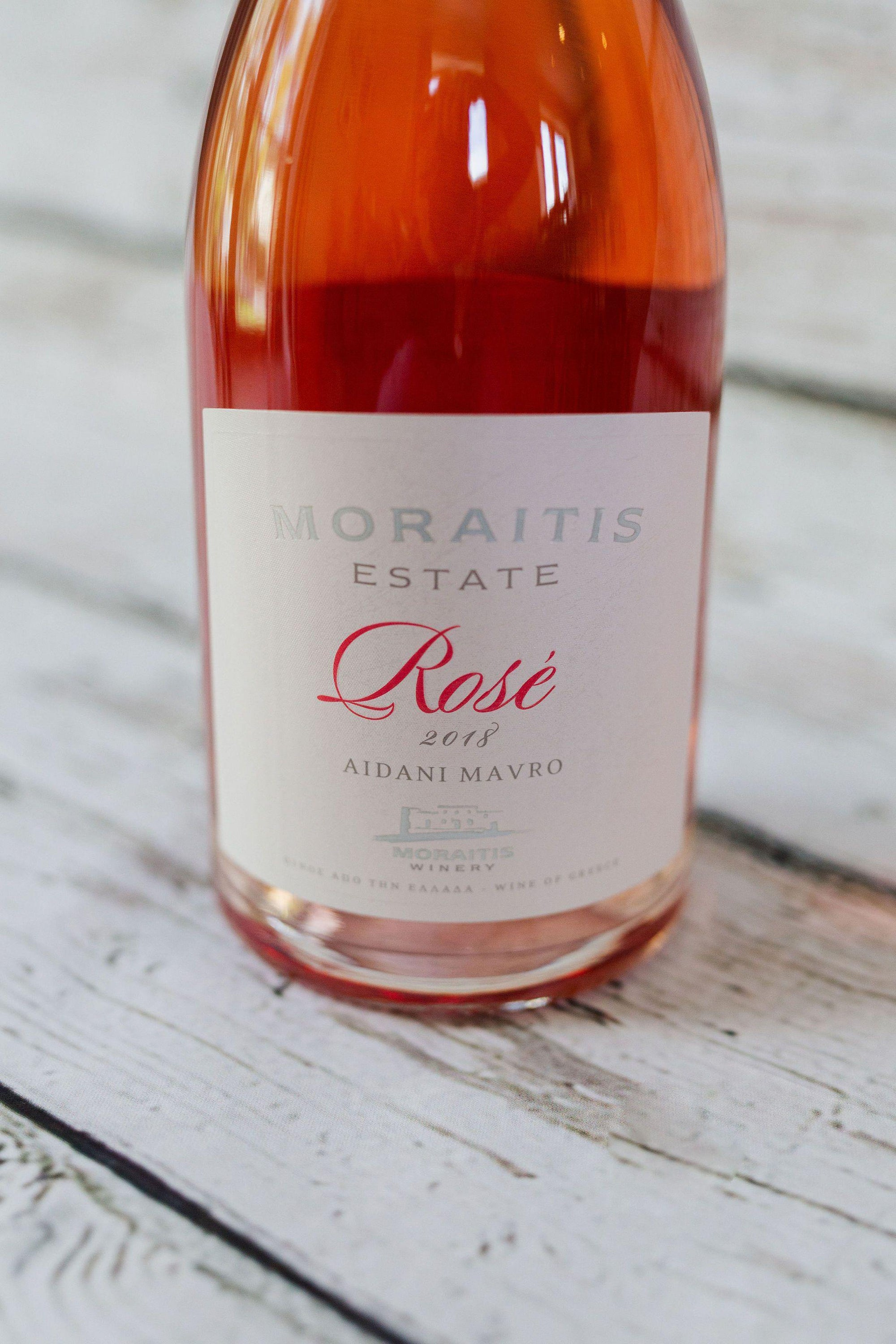 750ml clear glass bottle of Moraitis Rosé Wine with front label and silver foil cap