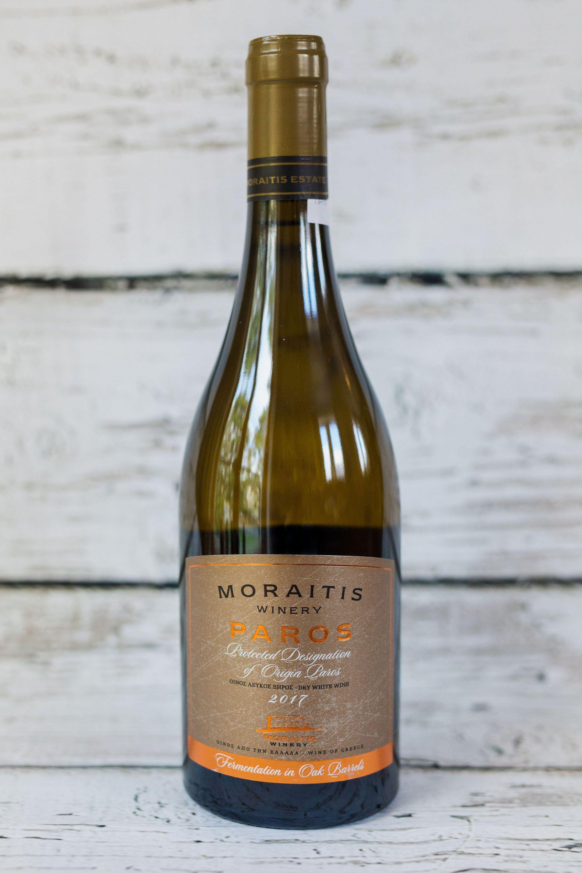 750ml clear glass bottle of Moraitis Paros white Wine with front label and brown foil cap