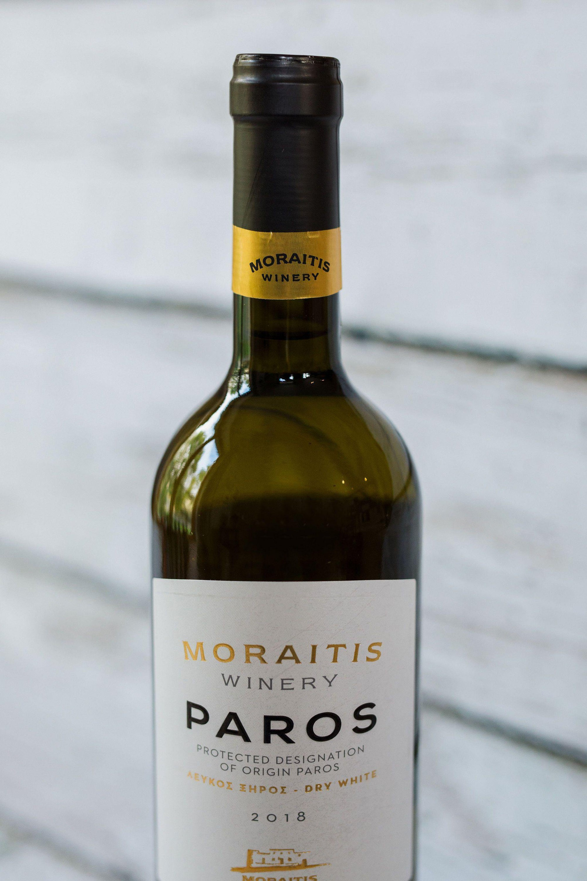 750ml green glass bottle of Moraitis Paros white wine with front label and black foil cap
