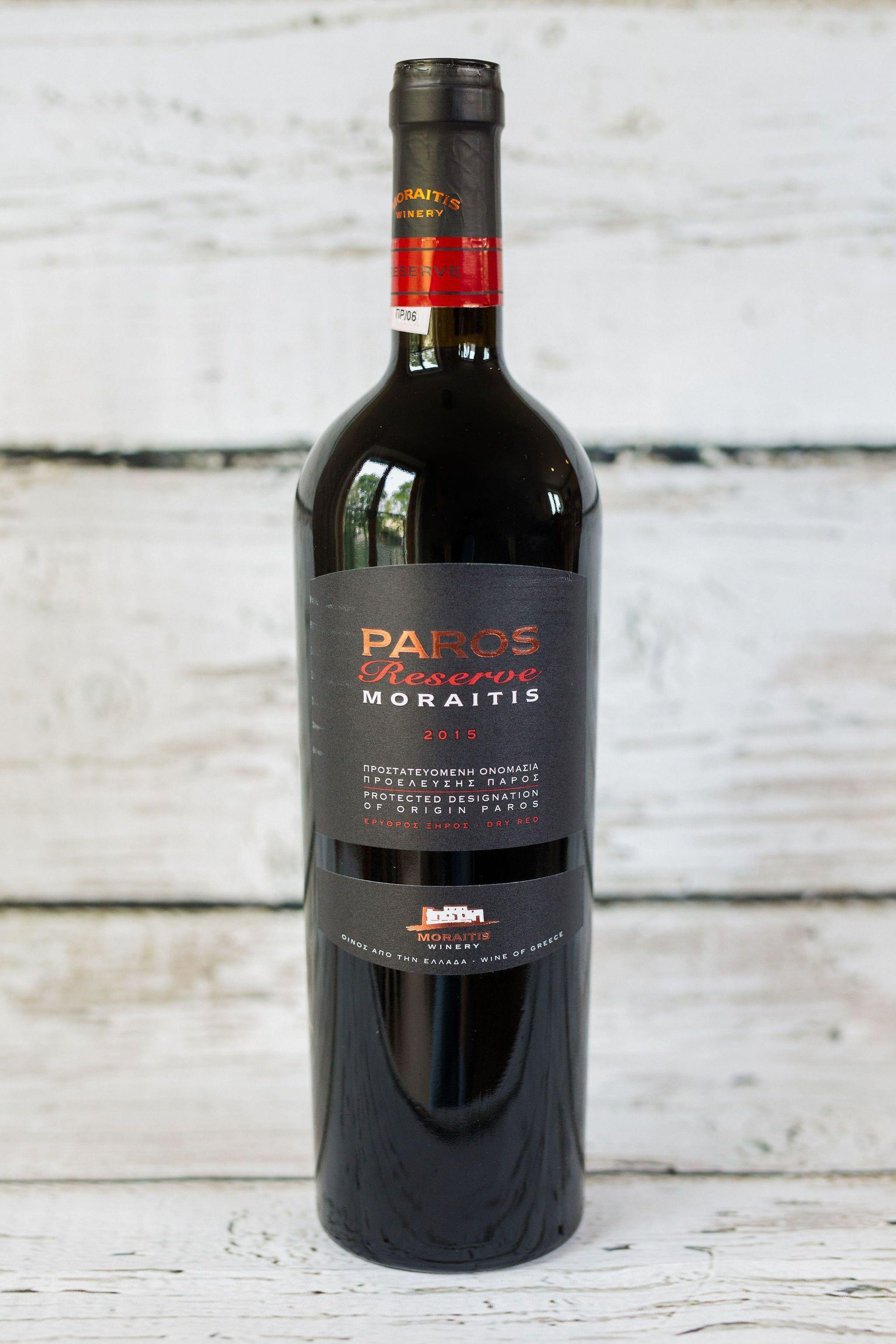 750ml brown glass bottle of Moraitis Paros Reserve red wine with front label and black foil cap