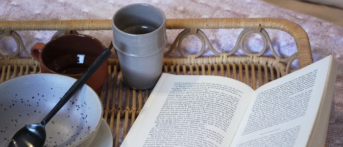 morning breakfast with a book and empty bowl and coffee mug