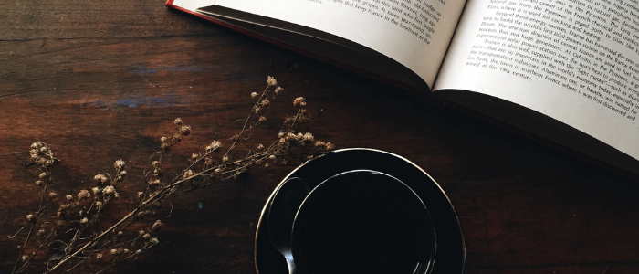 overhead view of morning coffee and book