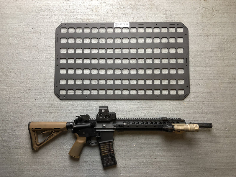 Rifle with tactical panel for gun safe designed as a gun holder