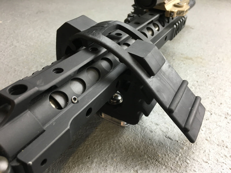 Rifle locked in place to be mount in a vertical position