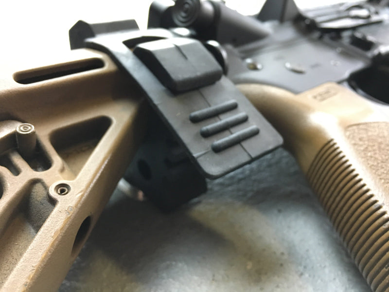 Rifle attached to rubber mounting for vehicles panel
