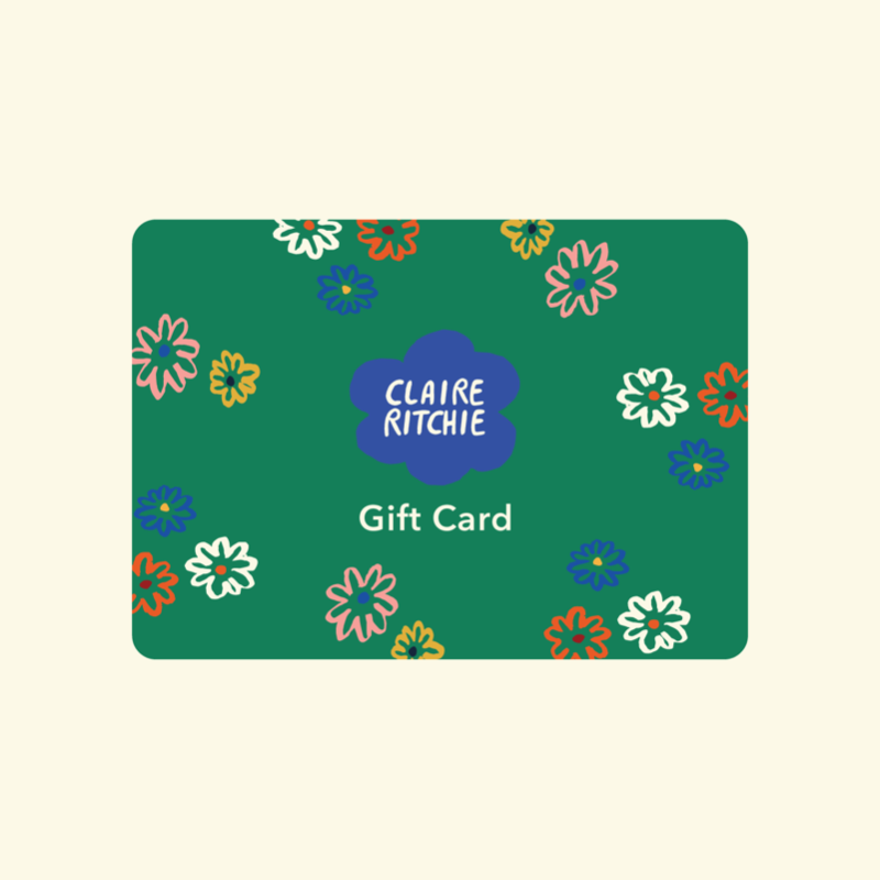 This image shows a green Claire Ritchie gift card with the logo in the center, surrounded by smaller flowers and the words 'Gift Card' below the center.