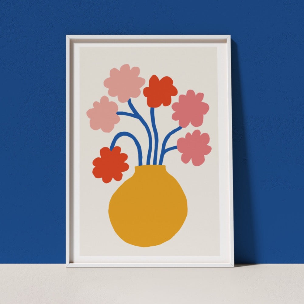 A colourful Giclée Art Print featuring  a yellow vase holding blue-stemmed flowers with pink and red blooms. A cheerful addition to any space.