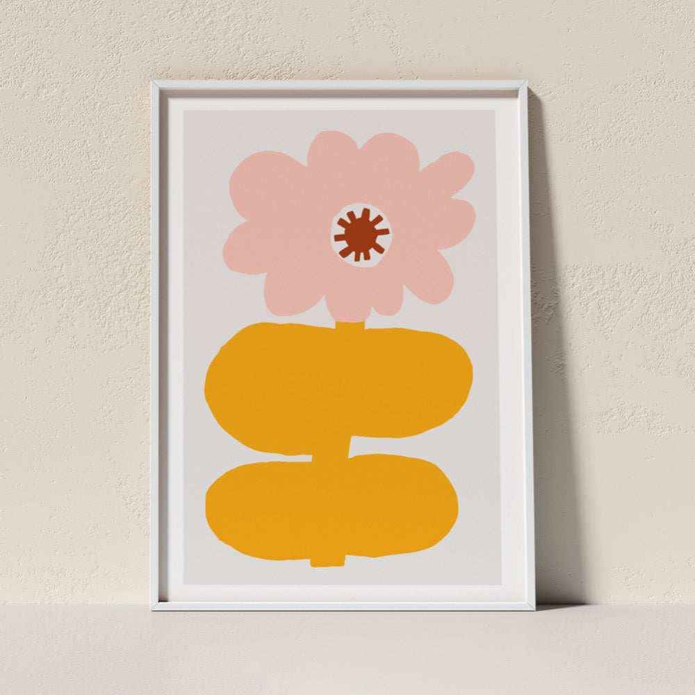 A colourful Giclée Art Print featuring a cloud-like pink petaled flower with a dark red center, held up by an egg yolk yellow stem and thick, sturdy leaves. A happy addition to any space.